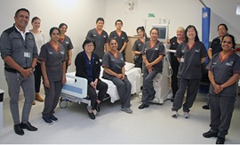 A group of male and female healthcare workers in a treatment room