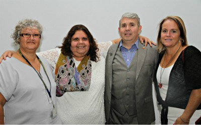 A group photo of three women and one man