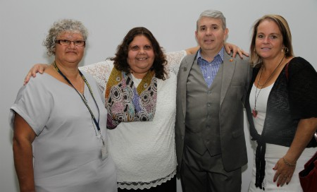 A group photo of three women and one man at the Hospital Hotline launch