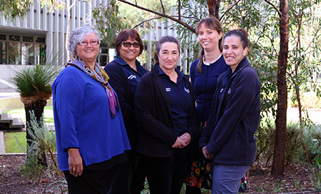Five Aboriginal women standing in a garden