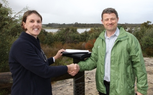 Photo of FSH Manager Offsite Coordination Chris Murray presenting the Beeliar Regional Park handover report to Renee Evans, Acting Manager Regional Parks Unit DPaW